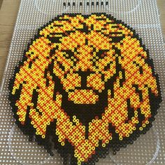 modele perle a repasser lion